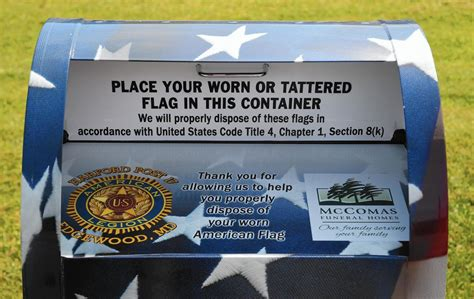 Flag drop-box vandalized, pulled off concrete at Edgewood