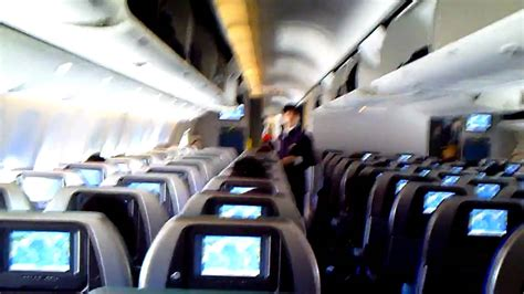 Inside a B 777-300 ER cabin Cathay Pacific - YouTube